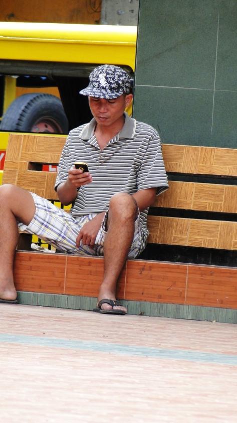 old man texting